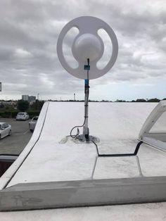 Coastline RV installing a Saturn 3000 antenna. Wind Turbine, Rv, Motorhome, Camper Tops, Truck Camper