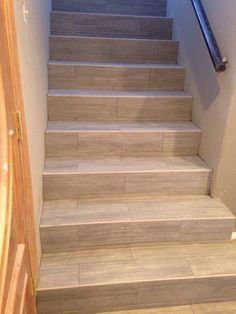 TFI Tile & Marble Design - Orange, CA, United States. Porcelain wood plank stairs