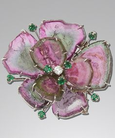 """MELLERIO """"Flower"""" brooch, in white gold and platinum, with tourmalines, green stones, diamonds, circa 1970, gross weight: 30g"""