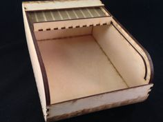A simple box with a top that disappears inside when opened. Why store your knick-knacks in boring square boxes? This box has nice round corners and box joints that accent its sides.