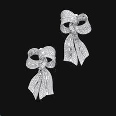 PROPERTY OF A PRINCELY FAMILY Pair of diamond ear clips, Bulgari Each designed as a bow, set with brilliant-cut and baguette diamonds, signed Bulgari.