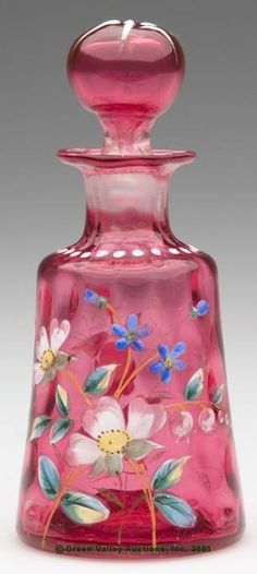 DECORATED CRANBERRY INVERTED THUMBPRINT PERFUME BOTTLE.                                                                                                                                                                                 More