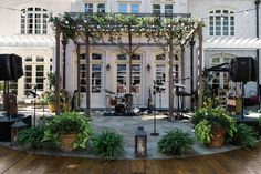 real wedding photo covid micro wedding backyard wedding evoke design and creative band stage on stonework wood dance floor Clear Tent, Downtown Hotels, Tent Reception, Ivory Roses, Wedding Backyard, Floral Event Design, Wedding Entertainment, Father Of The Bride, Hotel Wedding