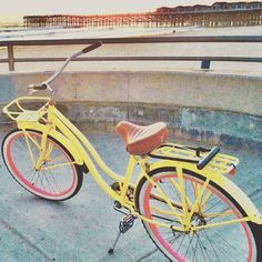 Sunset rides are a must #beachlife #beinspired #yellow #beachcruiser #thepier #sunsets #pacificbeach #nobaddays #sandiego #crystalpier #relax #breatheeasy #smile #rustyspokes