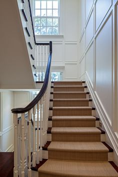 The exquisitely scaled paneling and stair details were carefully designed to reference the Georgian design of the exterior of this home and to create a graceful connection between the windows and landings.