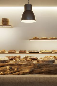 I IN is a Tokyo-based design office. The company pursues new possibilities in space design and, proposes impressive and surprising interiors. Bakery Interior, Retail Interior, Interior Design, Interior Architecture, Japanese Bakery, Bread Shop, Solid Wood Table, Shopping Street, Cafe Shop