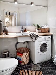 Hidden washing machine in bathroom