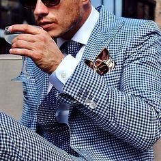 Blue gingham suit, blue polka dot tie and colorful pocket square