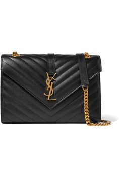 Black textured-leather (Calf) Snap-fastening front flap Comes with dust bag Weighs approximately 0.2lbs/ 0.1kg Made in Italy