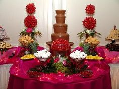 chocolate fountain foods Amber House Catering, Charlotte This is a Chocolate Fountain display. Just one of the many services that we offer! Cadbury Chocolate, Hot Chocolate Bars, Chocolate Flavors, Chocolate Desserts, Chocolate Fountain Wedding, Chocolate Fountain Recipes, Chocolate Fountains, Veggie Display, Fondue Fountain