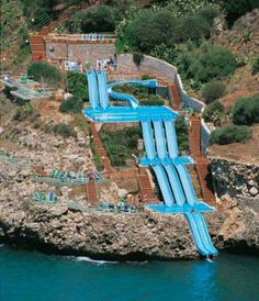 This really exists! At the Citta del Mare hotel in Sicily, you can slide right into the Mediterranean Sea.