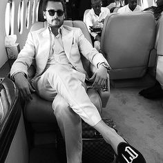 """From Europe with Love! Personal Snaps from Kim & Kanye's Wedding Weekend   WELL SUITED    Do we spy Kanye in the background? While jetting off to the next locale, a suave Scott Disick (aka """"Lord Disick"""") fits right in with the post-wedding entourage. """"Elegance at its finest,"""" he boasts on Sunday."""