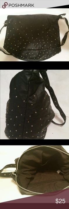 """New! Avon Mark Studly Crossbody Bag Black New in package, Mark by Avon """"Studly Bag"""" crossbody/shoulder bag in black faux leather with gold and silver stud embellishments. Adjustable shoulder strap. Measures approximately 14x14x4. From smoke-free home, ships within one business day, no trades, thank you! Avon Bags Crossbody Bags"""