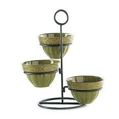 "VENETIAN HOME TRIPLE BOWLS AND STAND - PARSLEY    Casual enough for family dinners, yet dressy enough for the most elegant gathering, this trio of bowls with prestige brown metal stand features scrolls and scallops to add texture to their simple lines. Bowls are fired at a high temperature to increase durability and are oven, microwave and dishwasher safe. 7½ x 14"" 4 piece set.    Retail Price Was $48.00  Item: 934110  $29.00"