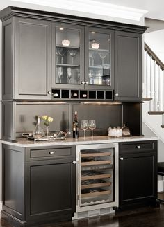 Built-in bar, with small drink fridge (I really want something like this someday if I ever really open a beauty bar!)