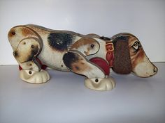 Vintage Fisher Price dog. This one is missing his tail & the pull string. It was one of my very fav toys :)