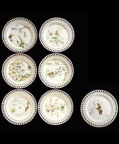 Emile Gallé,a group of seven faience plates,1870's each enamelled with flowers, insects or fish and inscribed, `POUR VIVRE HEUREUX, VIVONS CACHÉ',Goût à l'une, Goût à l'autre,et pense,à tout moment,qu'elle fait aller la cuisine', SUIVEZ,SUIVEZ, TOUJOURS LE FOND DE LA RIVIERE',A tout venant je chantois Ne vous déplaise', `C'EST TOIT DU TEMPS QUE LA REINEBEBERHE FILOIT', `On prend plus de mouches avec du miel Qu'avec du vinaigre',and `Il en coût trop pour briller dans le Monde' 22.5