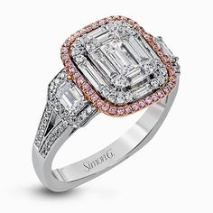 This dramatic contemporary white and rose gold ring is highlighted by a sparkling halo set with .11 ctw pink diamonds and accented with .35 ctw round cut white diamonds, .38 ctw emerald cut diamonds, and .65 ctw baguette cut diamonds. Print Page