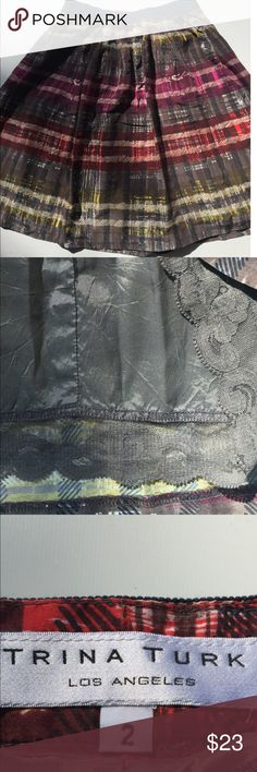Trina Turk Tidepool silk pleated plaid skirt A deconstructed plaid patterns the accordion pleats of a swingy silk skirt topped with a contrasting ribbon waistband. knee-length Side zip closure. Pattern placement may vary.Fully lined. Silk; dry clean. Like Good condition size 2 Trina Turk Skirts A-Line or Full