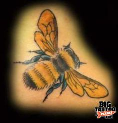 My mom's name is Debra... Hebrew for bee. Seriously considering a similar tattoo.