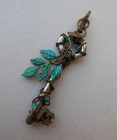 Water Tree Wire Wrapped Key Pendant -- Blue-green leaves, antique brass wire, green and blue Swarovski crystals