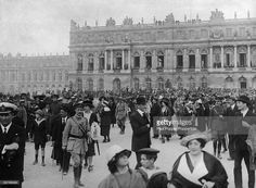 Crowds outside the Palace of Versailles immediately after the signing of the Treaty of Versailles, 28th June 1919. (Photo by Paul Popper/Popperfoto/Getty Images