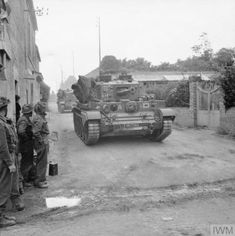 Cromwell tanks of Northamptonshire Yeomanry, Armoured Division, passing through Herouvillette, 14 June 1944 Ww2 Pictures, Military Pictures, Ww2 Photos, Photographs, Cromwell Tank, British Army, British Tanks, Military Armor, Armored Fighting Vehicle