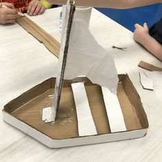 Student's cardboard sculpture of a sailboat.