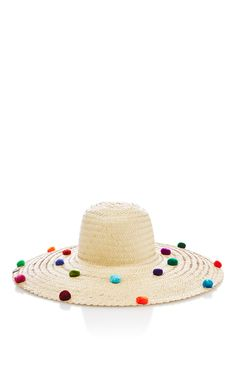 Nannacay bags are made from fibers extracted from the Peruvian Coast, each bag is unique and dyed by hand. All pom-poms are made in the Andes at an altitude of 3,700 meters. This **Nannacay** hat is hand-crafted by Peruvian artisans in natural raffia straw and features allover pom-pom embellishments in multiple colors.