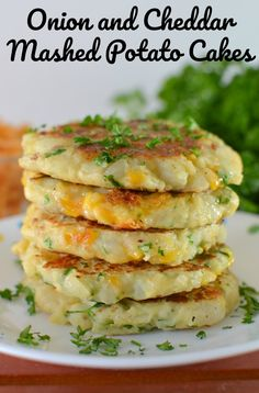 Onion and Cheddar Mashed Potato Cakes Recipe - - This is one of the best recipes to use leftover mashed potatoes, especially after the holidays! A mixture of fresh herbs, garlic and some cheesy goodness makes this potato pancake perfection! Cheesy Mashed Potatoes, Leftover Mashed Potatoes, Mashed Potato Recipes, Mashed Potato Patties, Recipe For Potato Cakes, Potato Side Dishes, Vegetable Dishes, Veggie Food, Vegetarian Recipes