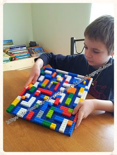 Make a Lego marble maze. For Webelos engineer activity badge? This is spatial, tactile, logical, requires clever thinking and some trial and error.