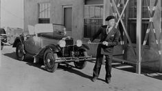 circa 1930: American comic actor and clown of the silent screen, Buster Keaton (1895 - 1966), born Joseph Frank Keaton, tows his convertible car. (Photo via John Kobal Foundation/Getty Images)   - Esquire.com