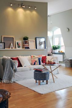 Like this shelving idea with frames above couch. Even the lighting since my living room has no light Home Living Room, Apartment Living, Living Room Decor, Living Spaces, Attic Apartment, Apartment Interior, Living Area, Living Room Inspiration, Interior Inspiration