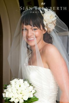 Bride with white flower in her hair