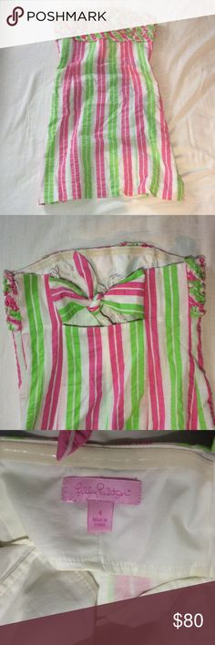 Strapless Lilly Pulitzer Dress Pink white and green strapless Lilly Pulitzer dress. Worn once. Ruffled top. Zipper up the side with a tie in the back. Lilly Pulitzer Dresses Strapless