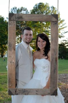 Hang a large wooden frame from a tree and have cameras ready to take pictures of the wedding party and guests. Add a suitcase of fun hats and glasses beside it and you have entertainment for your guests and a way to remember them on your special day!