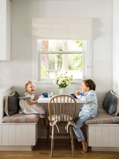 The kid-proof breakfast nook with Carolina Irving Aegean Stripe linen cushions, and vintage indigo pillows from Galerie Half.
