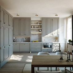 Swedish Kitchen with Gray Painted Cabinets & Marble Backsplash Steel Counter tops with marble backsplash and grey cabinets Cheap Kitchen Cabinets, Grey Cabinets, Painting Kitchen Cabinets, Shaker Cabinets, Kitchen Storage, Kitchen Cabinetry, Shaker Doors, Upper Cabinets, Kitchen Units
