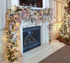 This beautiful Christmas garland over the fireplace mantel commands your attention so you don't notice the TV above it, via reginagust.com | How To Decorate a Christmas Mantel With a TV Above It