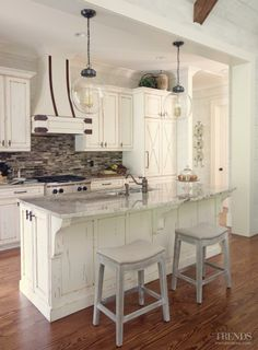 A whitewashed, New England-style aesthetic can work very well in a classic kitchen project. Following up with distinctive accents that build on the overall design will create connections to other areas in the house and the outdoors.
