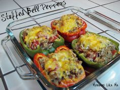 Mommas Like Me: Stuffed Bell Peppers - I left rice out of the inside and served over a small bit of brown rice instead with a salad. One half of a large pepper with 2/3 c rice and salad was plenty to fill me up.
