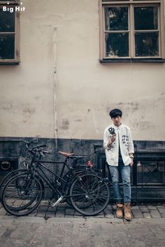 """[BTS in Sweden: Mischievous boys in Europe] - JUNGKOOK Date: July 30th 2014 Location: Gamla Stan, Stockholm """"Those became magazine photos thanks to the beautiful streets although we took them roughly. Whenever sitting on the steps, leaning against the wall, and just walking on the street, they made pictorial photos! Because of the sudden rain during the shooting, they got embarrassed but soon posed naturally with umbrella."""""""
