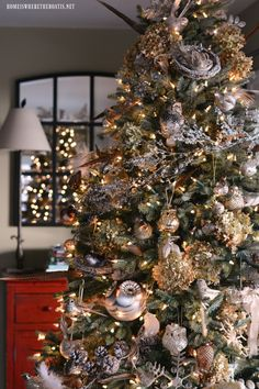 Winter Nesting Tree with birds, dried hydrangeas, pheasant feathers, pinecones, icy branches and snowflake ornaments | Homeiswheretheboatis.net #Christmastree #natural Natural Christmas Tree, Christmas Tree Themes, Christmas Mantels, Holiday Tree, Gold Christmas, Rustic Christmas, Beautiful Christmas, Christmas Tree Ornaments, Christmas 2017
