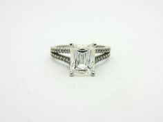 A stunning platinum ring featuring an amazing 1.88ct fancy criss cut diamond.