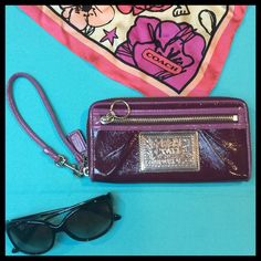 """COACH: Poppy Patent Leather Purple Wristlet Wallet Wristlet is in good used condition. Two shades of purple (darker one is like a deep grape purple) with leopard print interior details. Patent leather. This is my sisters wristlet & I am selling for her. Clean, authentic & oh so cute! Width = 7 1/2"""" Height = 4"""" Depth = 1"""". I love to bundle & reasonable offers are always welcome! Please remember to always use the offer button.  Coach Bags Wallets"""