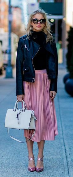pink pleated skirt. leather biker jacket. #streetstyle