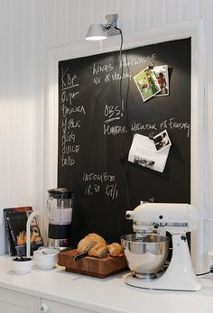 ooo i  like the chalk board in the kitchen, plan out the weeks meals - would really have to be a housewife to have time to do that