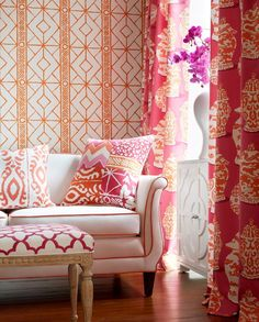The Dana Gibson Collection for Stroheim. Wallpaper: Twig – Orange; Drapery: Canton – Pink Orange; Sofa: Mian – White; Pillows: Madagascar – Persimmon & Parish Patch – Pink Orange; and Bench: Bombay – Pink.
