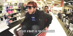 Mari pushing LaserCorn around in a trolley in Target.