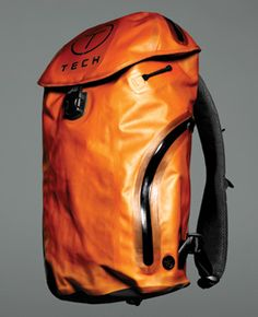 Orange rugged Tumi Backpack